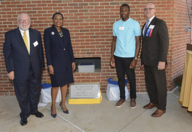 Pictured are faculty emeritus John Cronin, President Dr. L. Joy Gates Black, Student Goverment Association President Derek Washington and Board of Trustees Chairman Michael Ranck at the time capsule placement ceremony, part of the College's 50th Anniversary Celebration. Photo by Jim McWilliams Photography