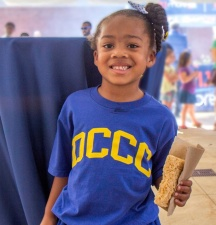 Quinn Franklin enjoys a sweet treat at Community Day. Photo courtesy of DCCC