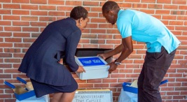President Dr. L. Joy Gates Black and SGA President Derek Washington place the new time capsule on Sept. 23. Photo courtesy of DCCC