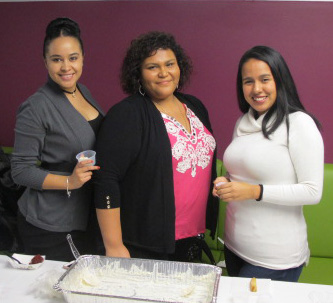 (From left to right) Yesenia Diaz Lopez, a business administration major; Edett Alfaro, a medical billing and coding major; and Valeria Bossio, a business administration major, hand out samples at the Colombia table.