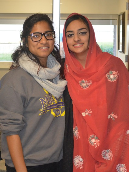 (From left to right) Naomi Helal and Kiran Kaur speak to students about the Bangladesh culture.