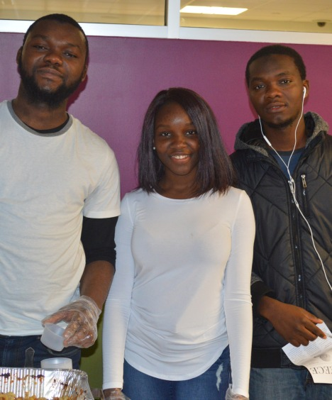 (From left to right) Mussa Kromah, Assitan Sissoko, and Youssouf Kromah hand out food samples at the Egypt table.