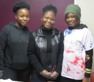 (From left to right) Jolene Quiah, a psychology major; Ralphina Perry, a social work major; and Esther Ekwale, a business administration major, hand out cake at the Canada table.